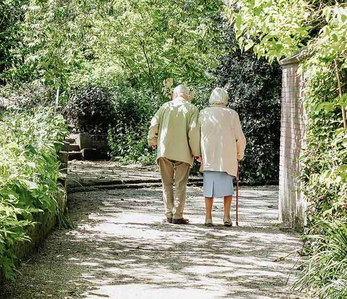 Picture of older couple walking on a path - LPA's